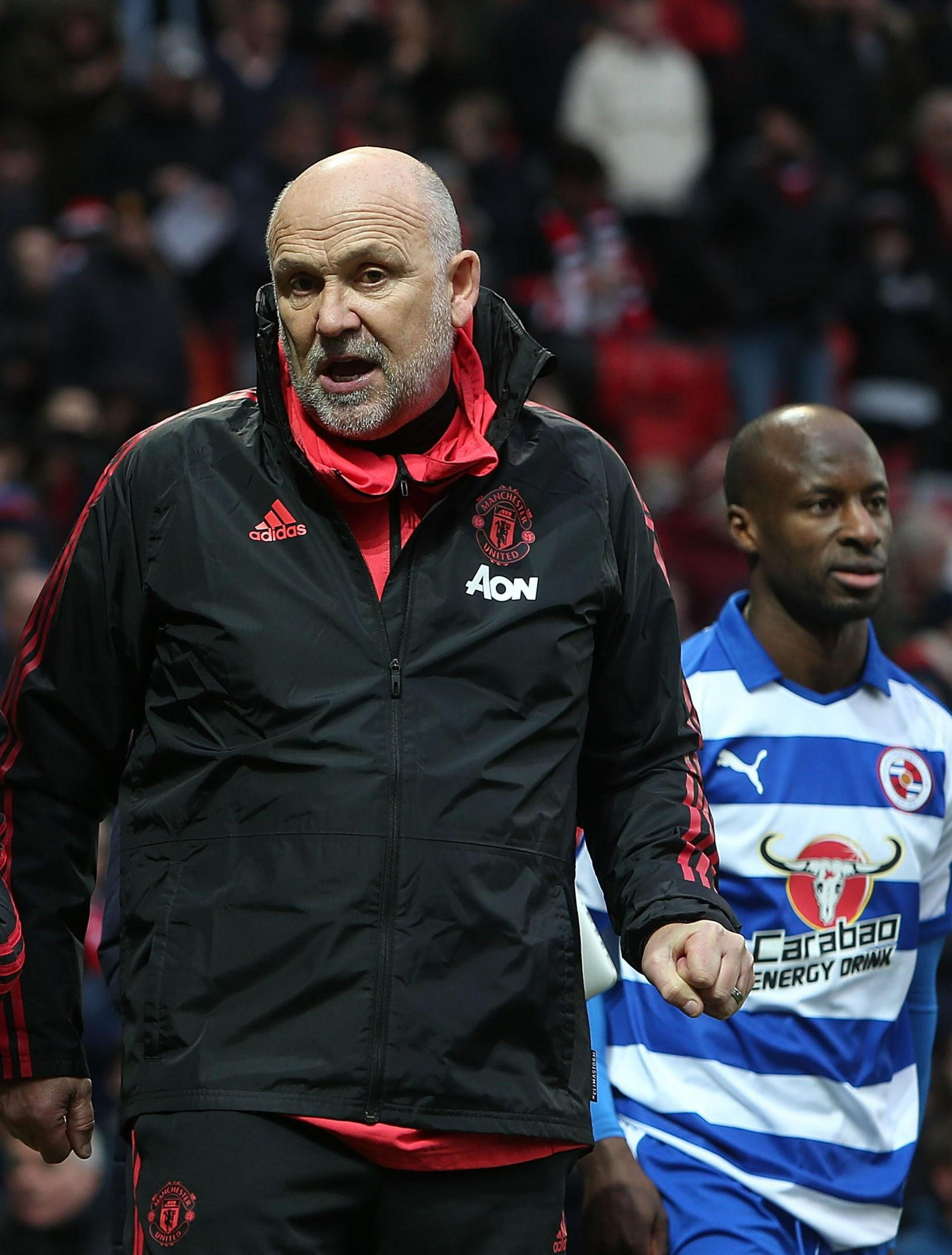 Mike Phelan on the pitch at Old Trafford after United's Emirates FA Cup win over Reading