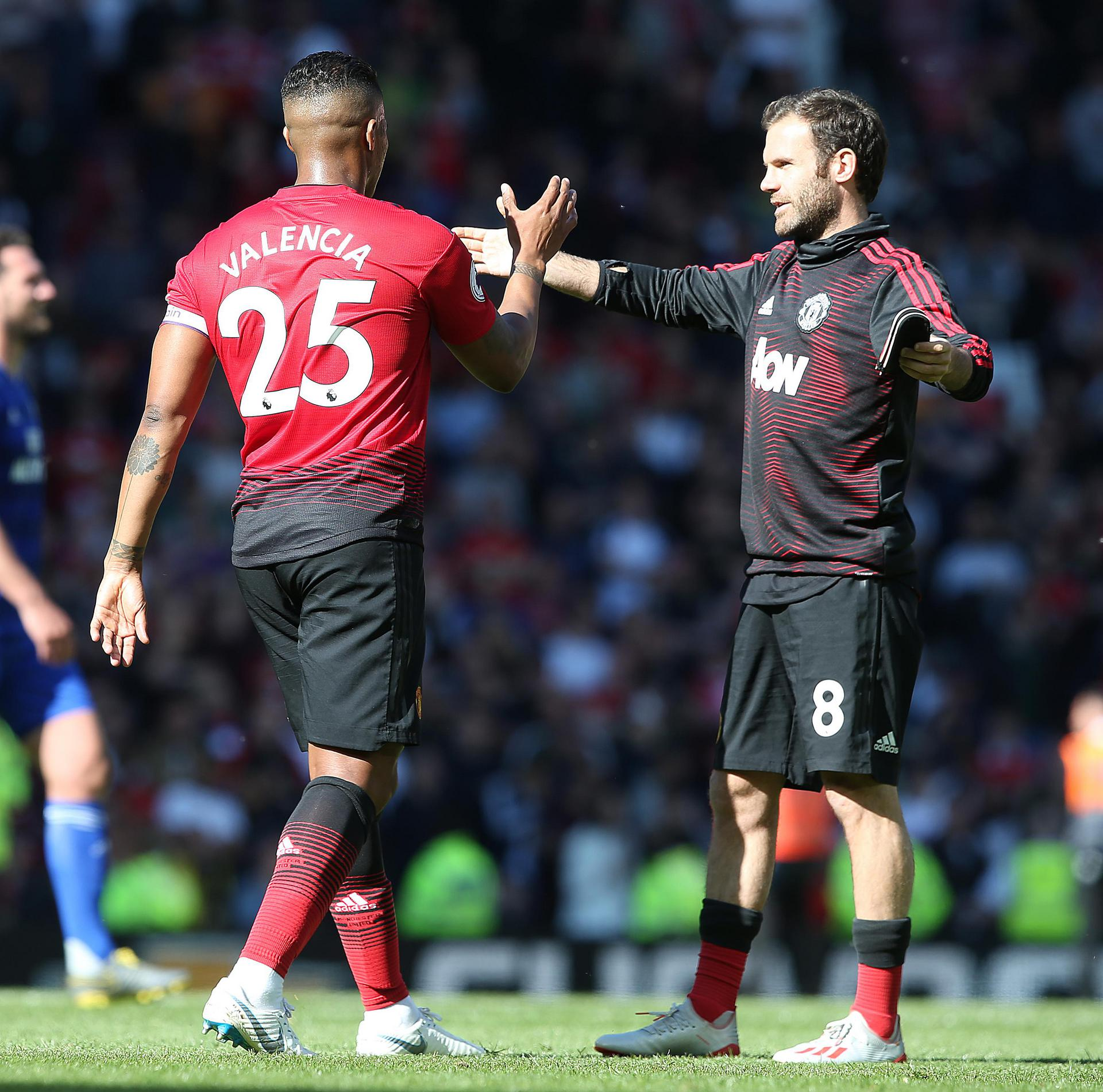 Juan Mata prepares to embrace Antonio Valencia after the final game of the season
