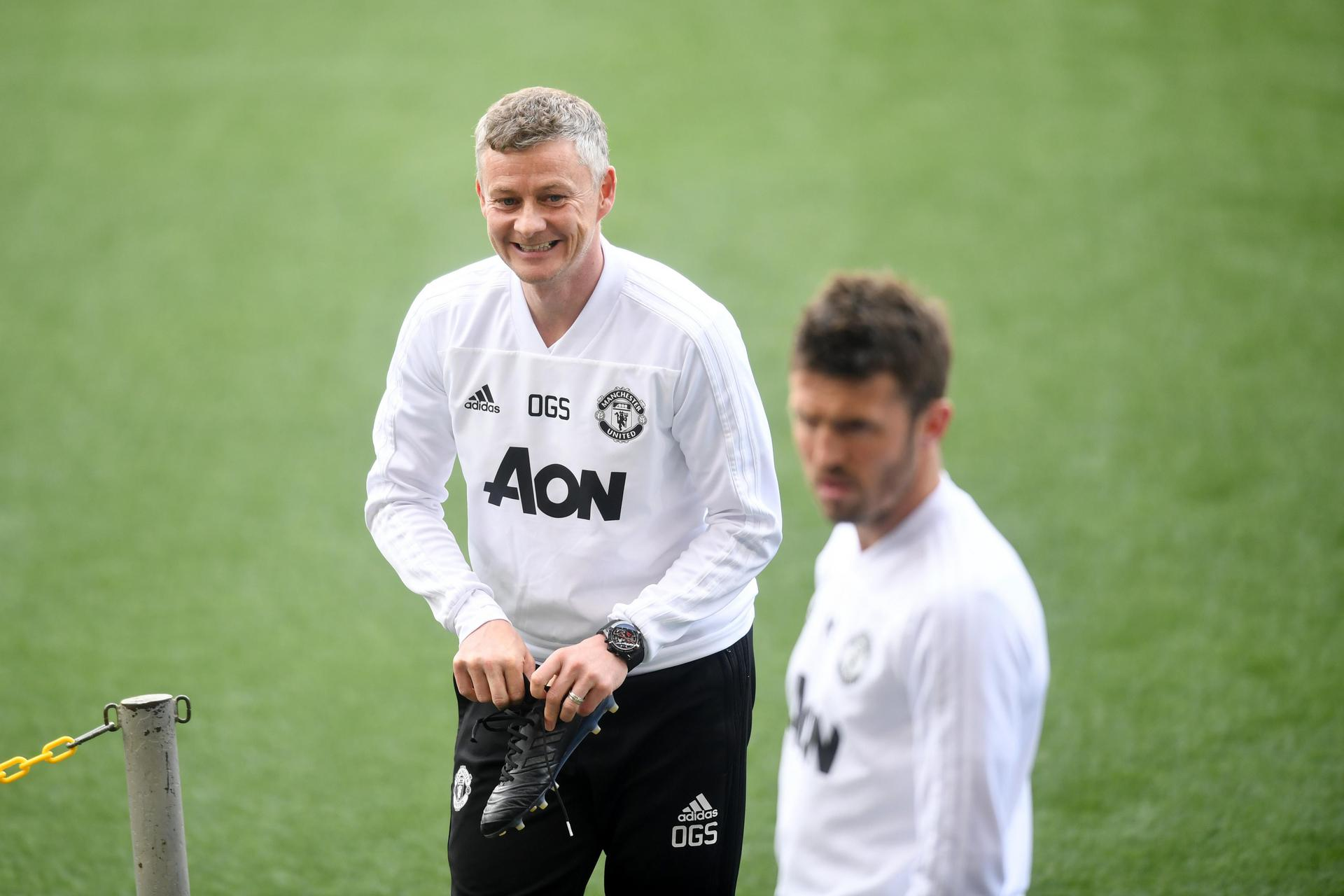 Ole Gunnar Solskjaer putting his boots on.