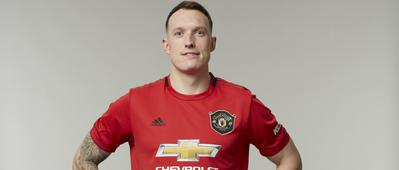 Phil Jones posing in his United kit.