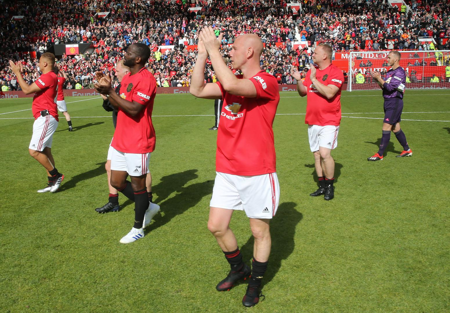 Nicky Butt applauds the supporters at Old Trafford.