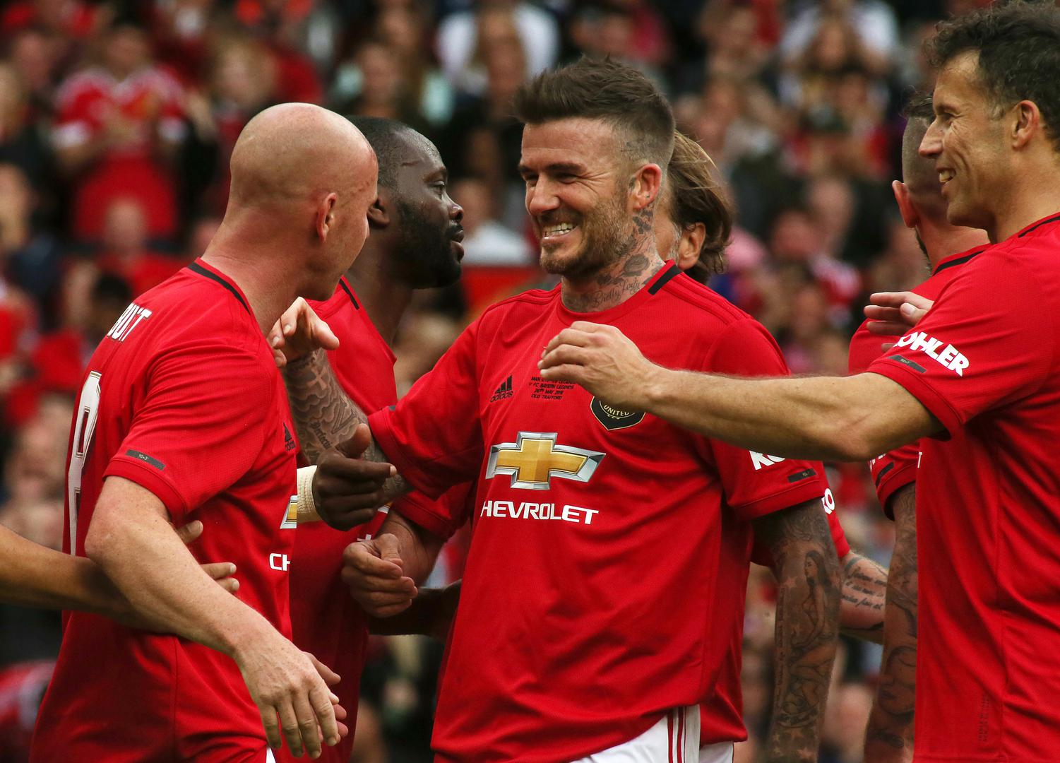 David Beckham celebrates scoring United's fifth goal in the Treble Reunion game at Old Trafford