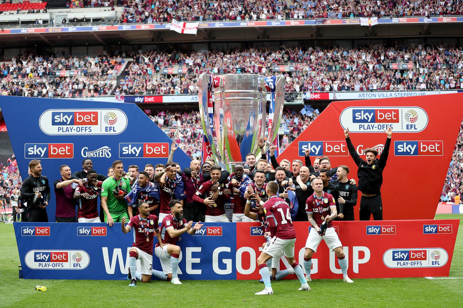 Aston Villa celebrate after winning the Championship play-off final at Wembley