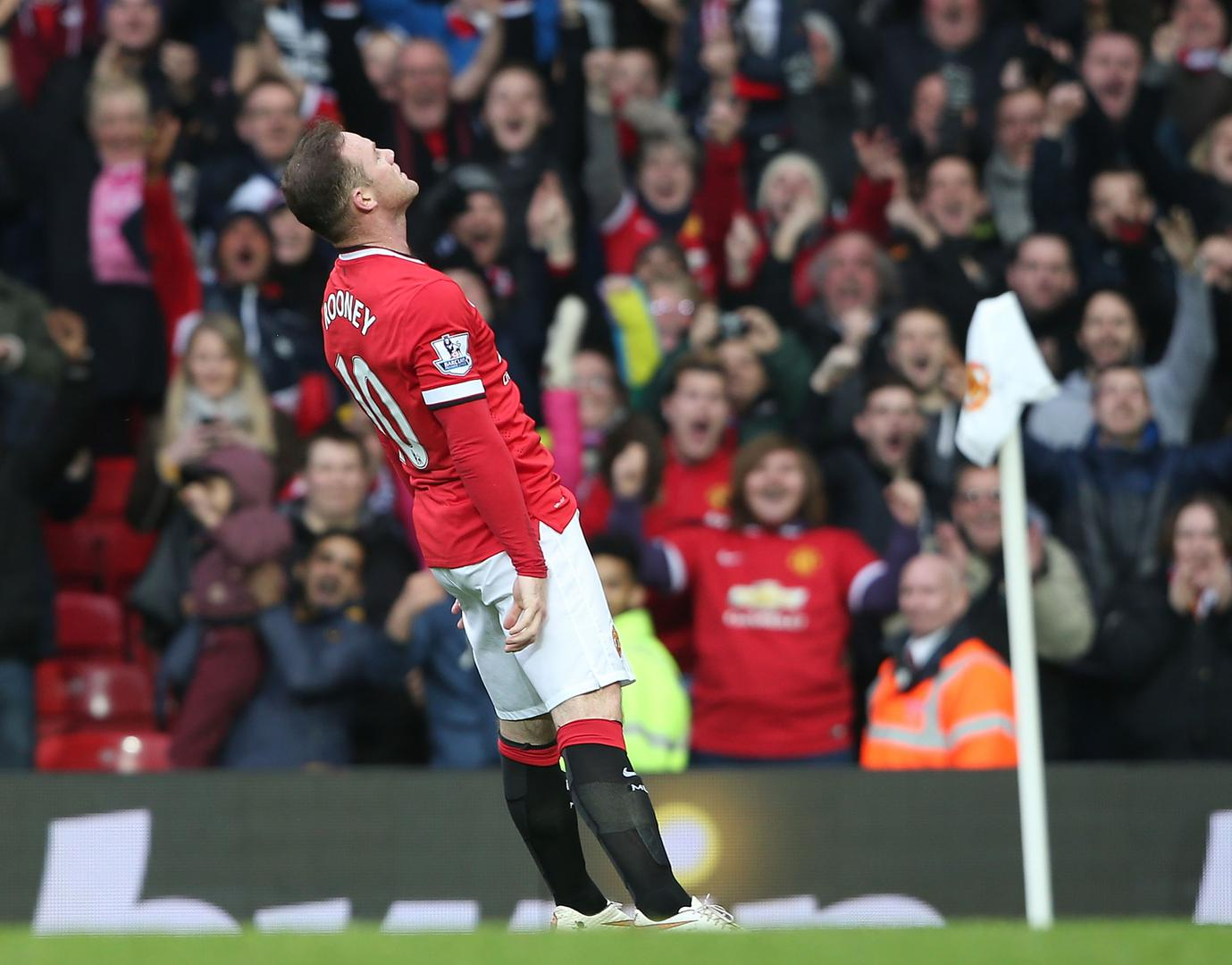 Wayne Rooney celebrating a goal against Tottenham at Old Trafford in 2015.,