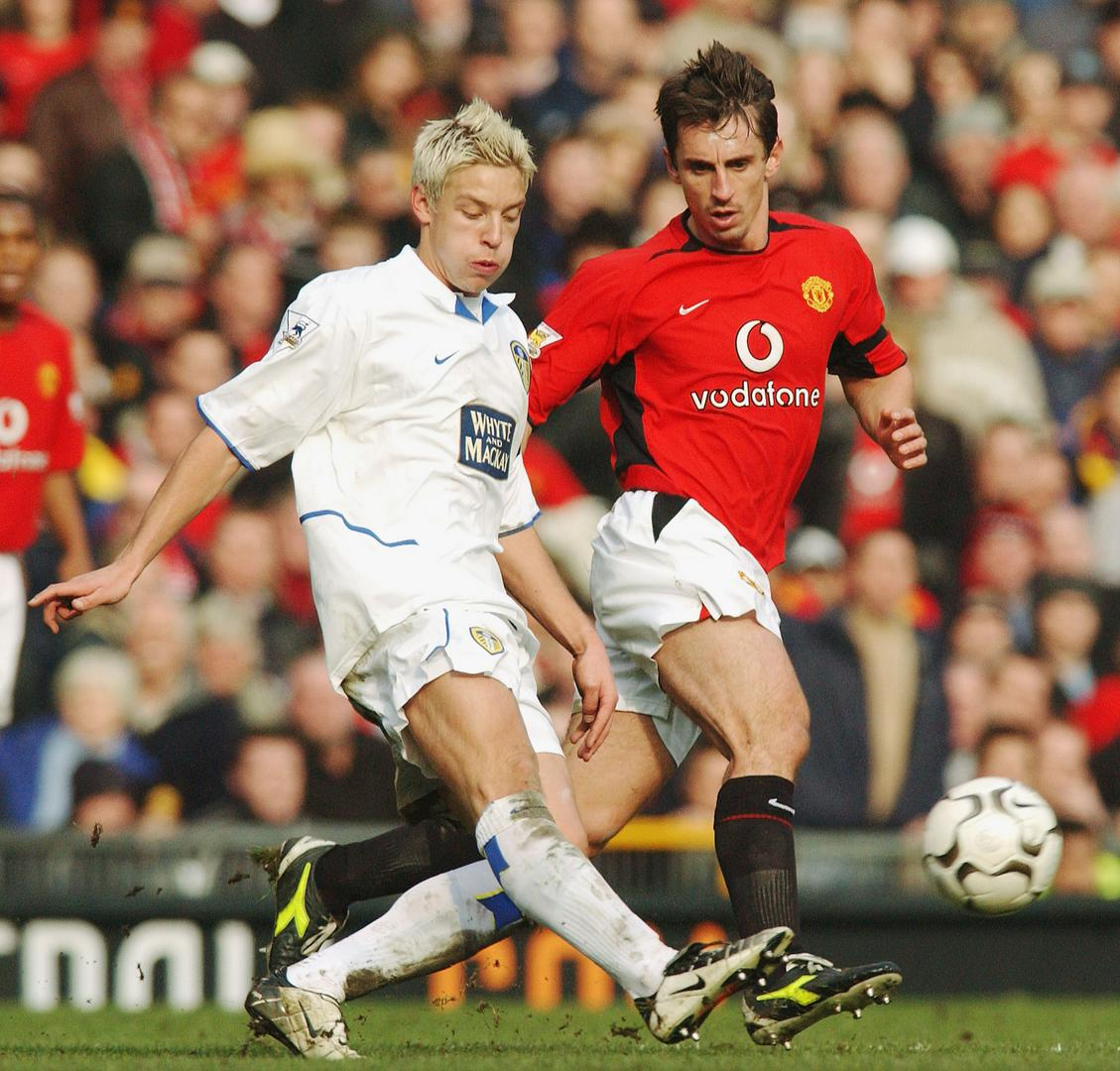 Alan Smith in action for Leeds against Manchester United defender Gary Neville