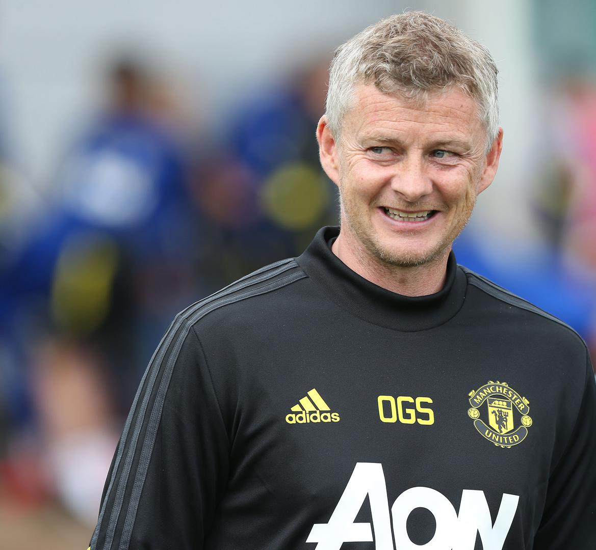 Ole Gunnar Solskjaer smiling at the Aon Training Complex.