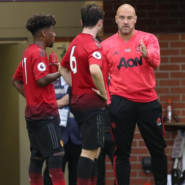 Neil Wood instructs Manchester United players.