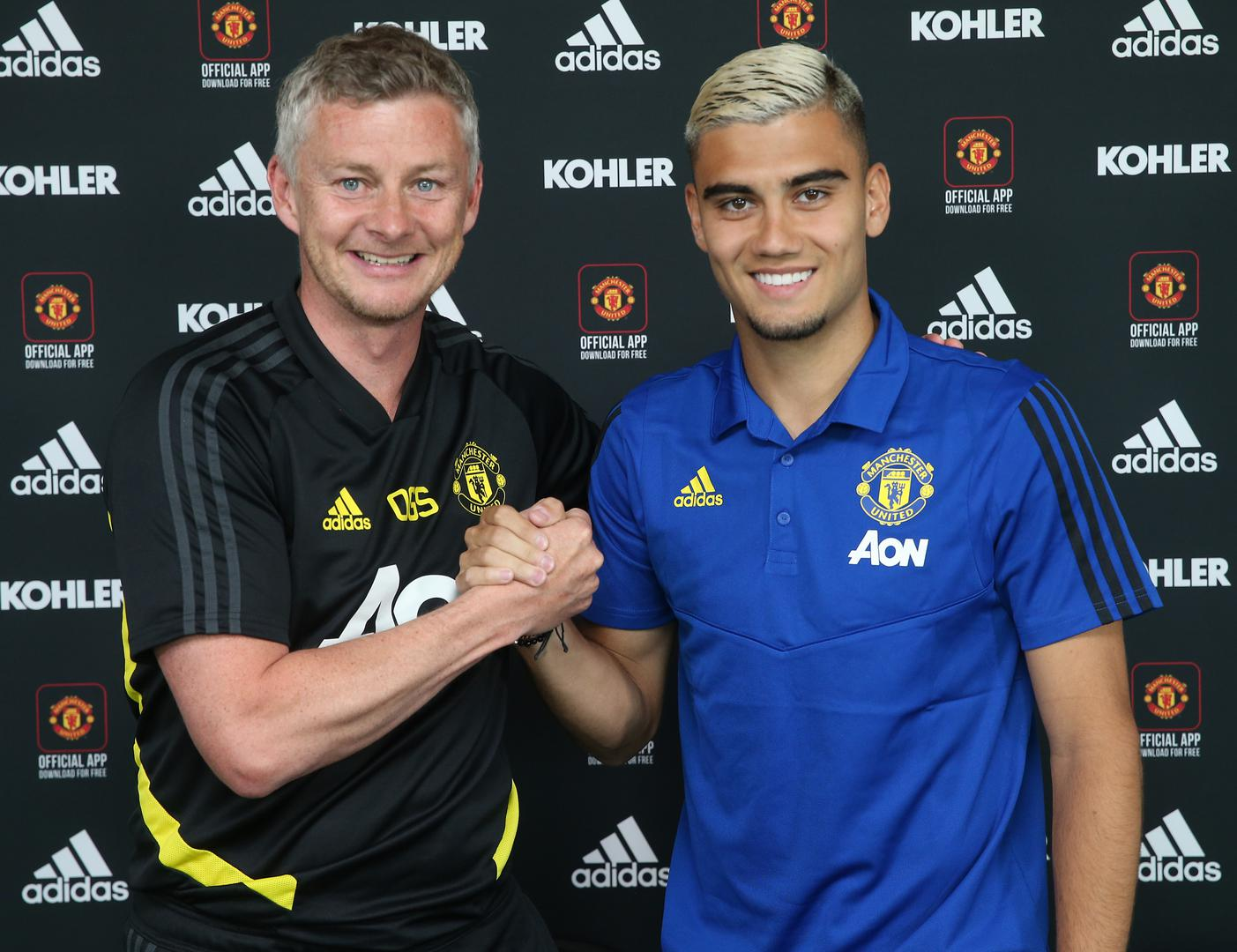 Ole Gunnar Solskjaer and Andreas Pereira shake hands at the Aon Training Complex.