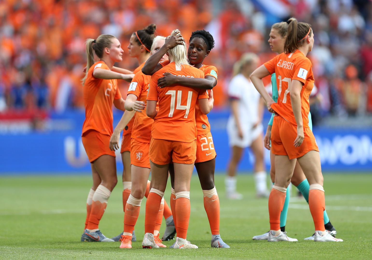 Jackie Groenen is consoled by her Netherlands team-mates.
