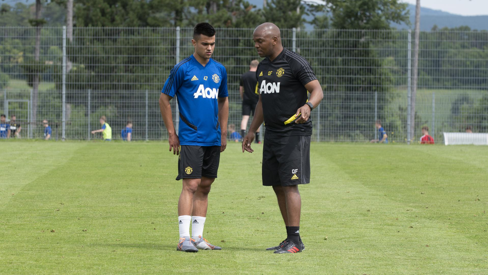 Arnau Puigmal chats with coach Quinton Fortune out in Austria.