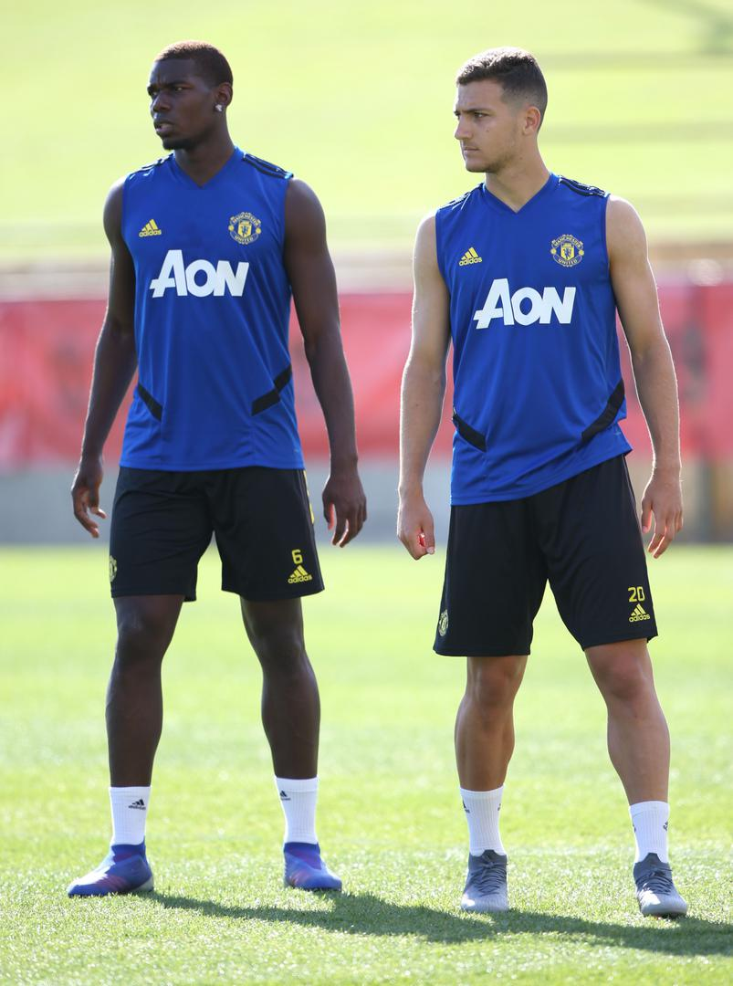 Paul Pogba and Diogo Dalot.,
