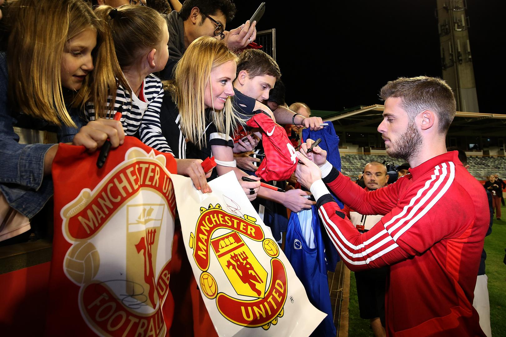 David De Gea signs autographs for Manchester United fans attending the squad's open training session at the WACA cricket ground