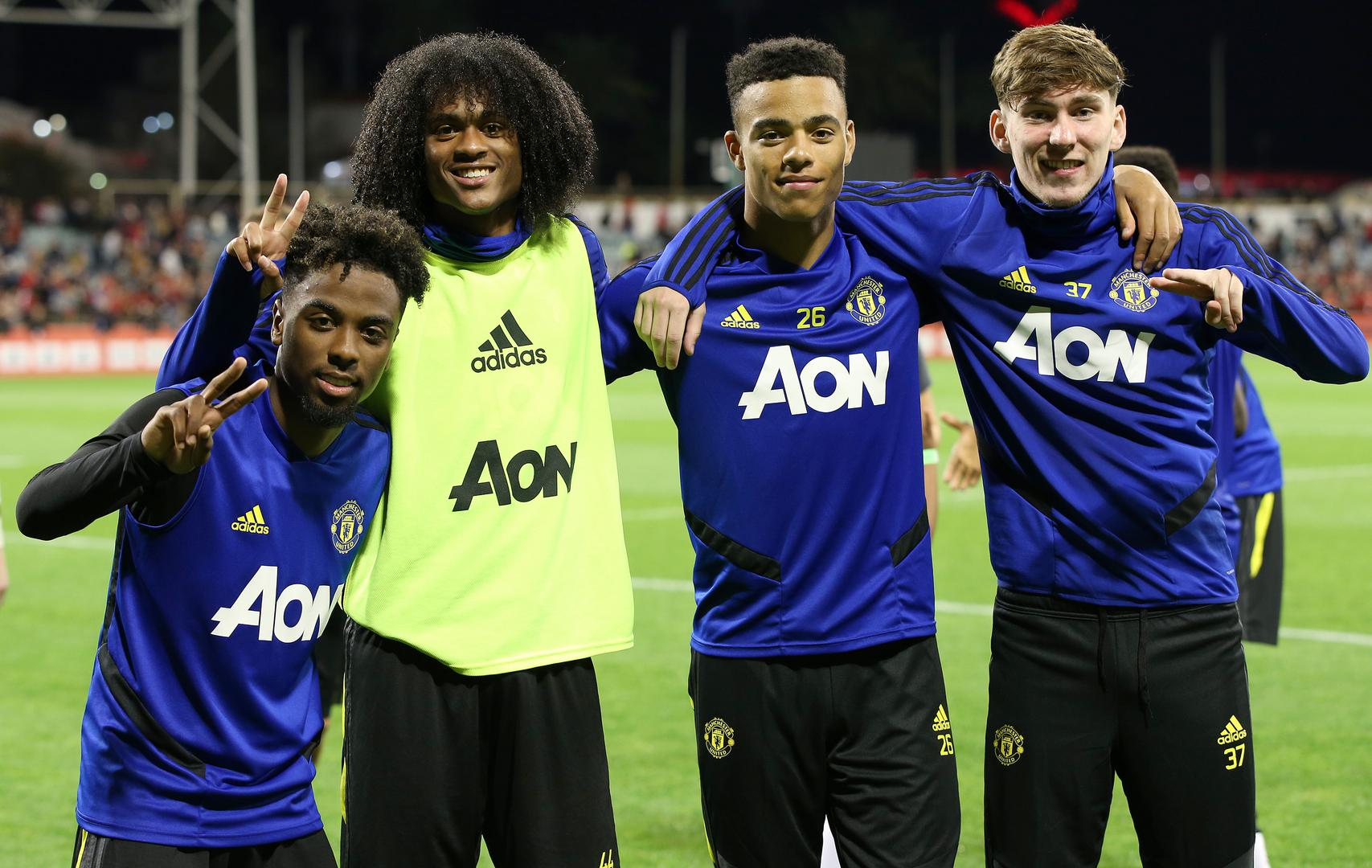 Angel Gomes, Tahith Chong, Mason Greenwood and James Garner pose for a photo on Tour 2019.