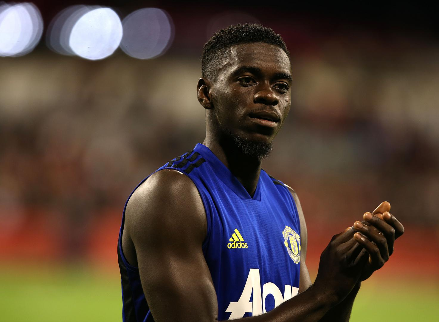 Axel Tuanzebe applauds the Manchester United fans who attended an open training session in Perth, Australia,