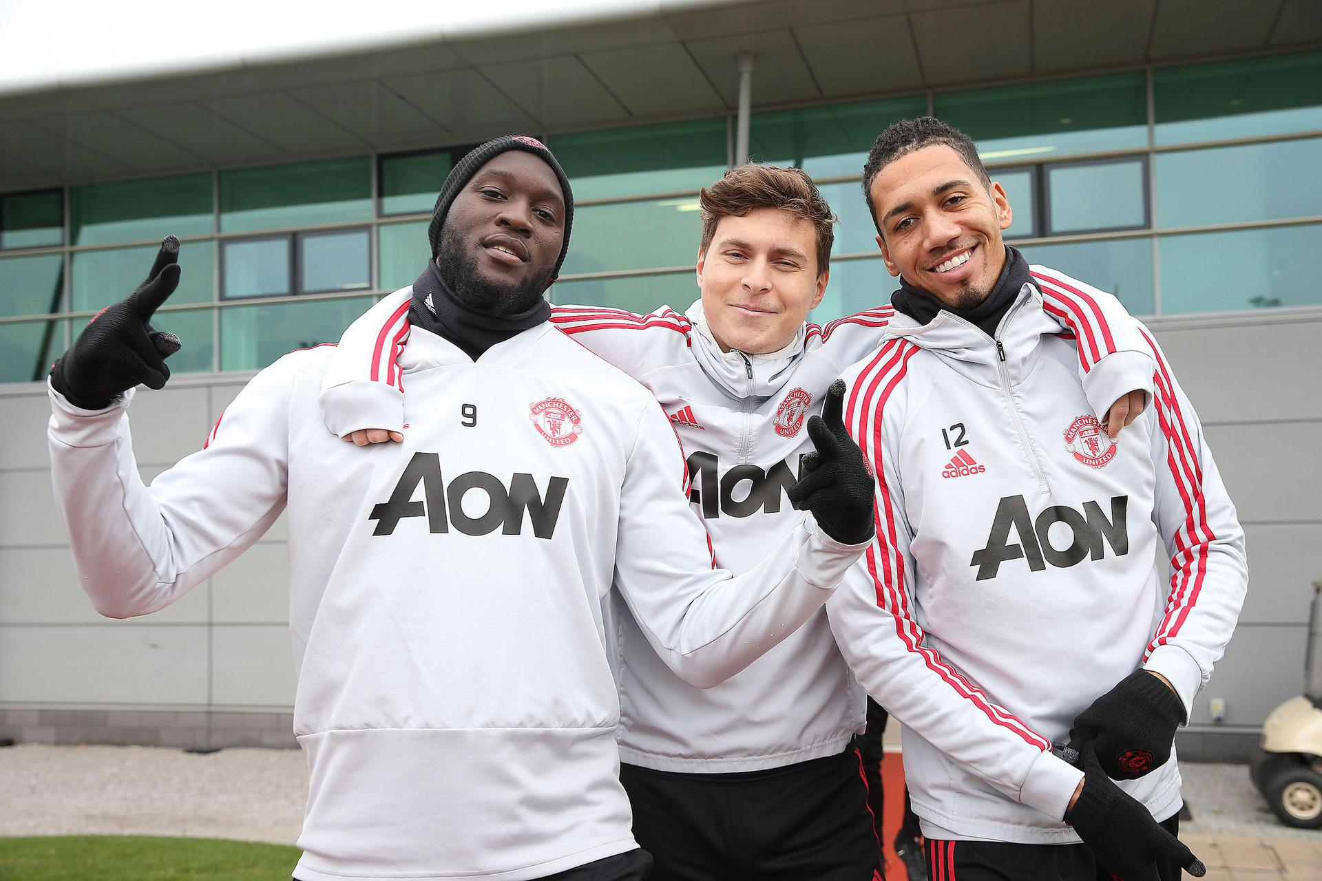 Romelu Lukaku, Victor Lindelof and Chris Smalling at the Aon Training Complex.q