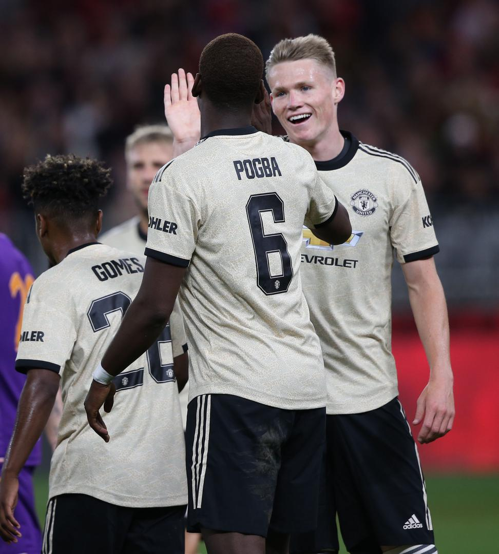 Paul Pogba and Scott McTominay on tour.,