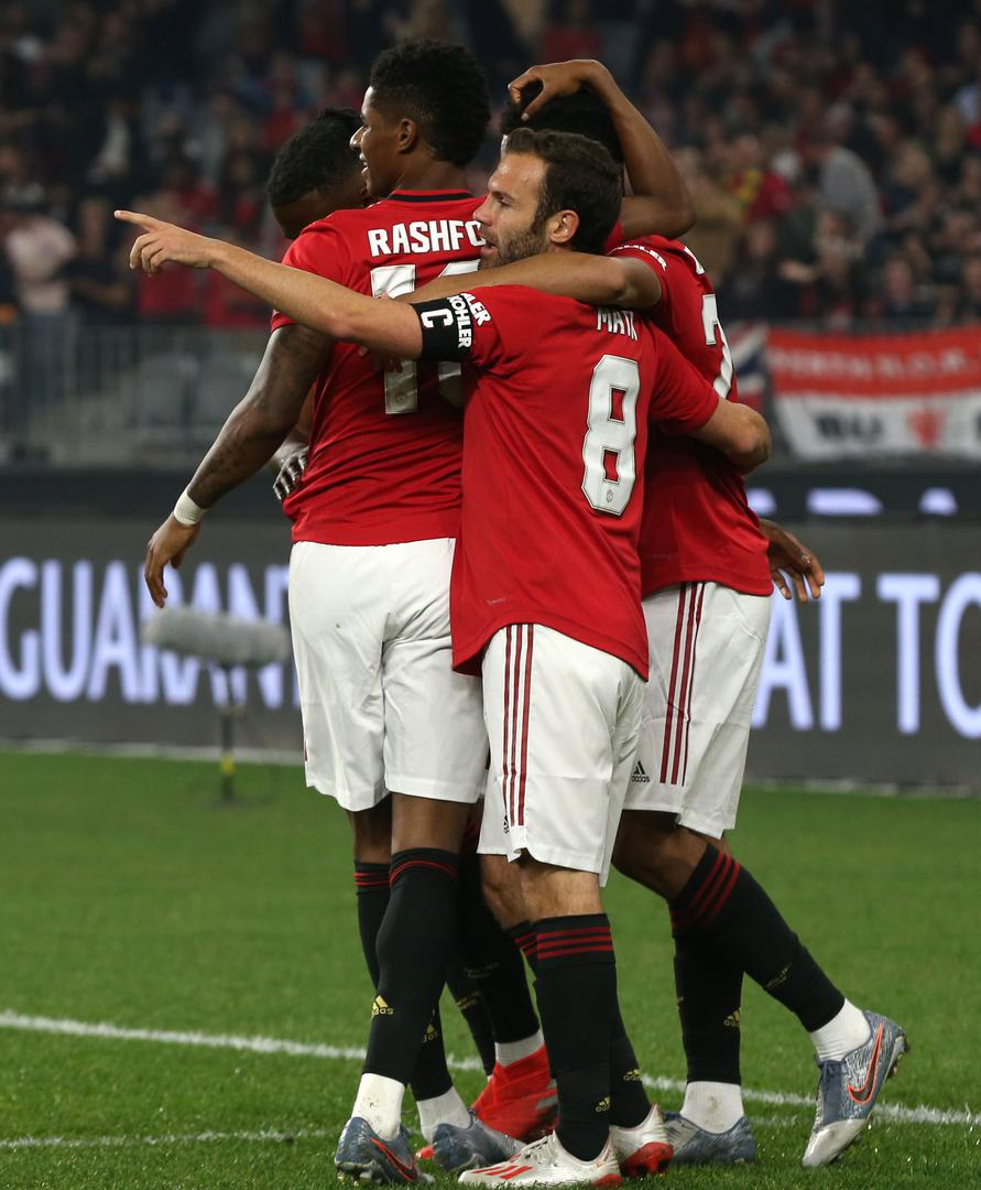 Juan Mata and Marcus Rash@ford celebrate a goal for Manchester United