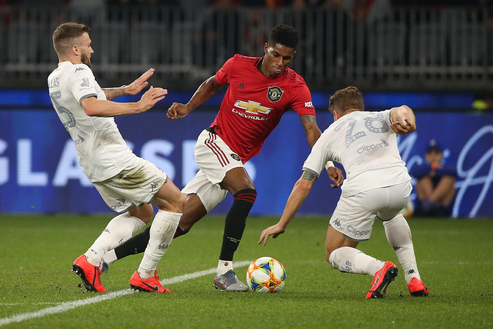 Marcus Rashford dances through the Leeds defence.