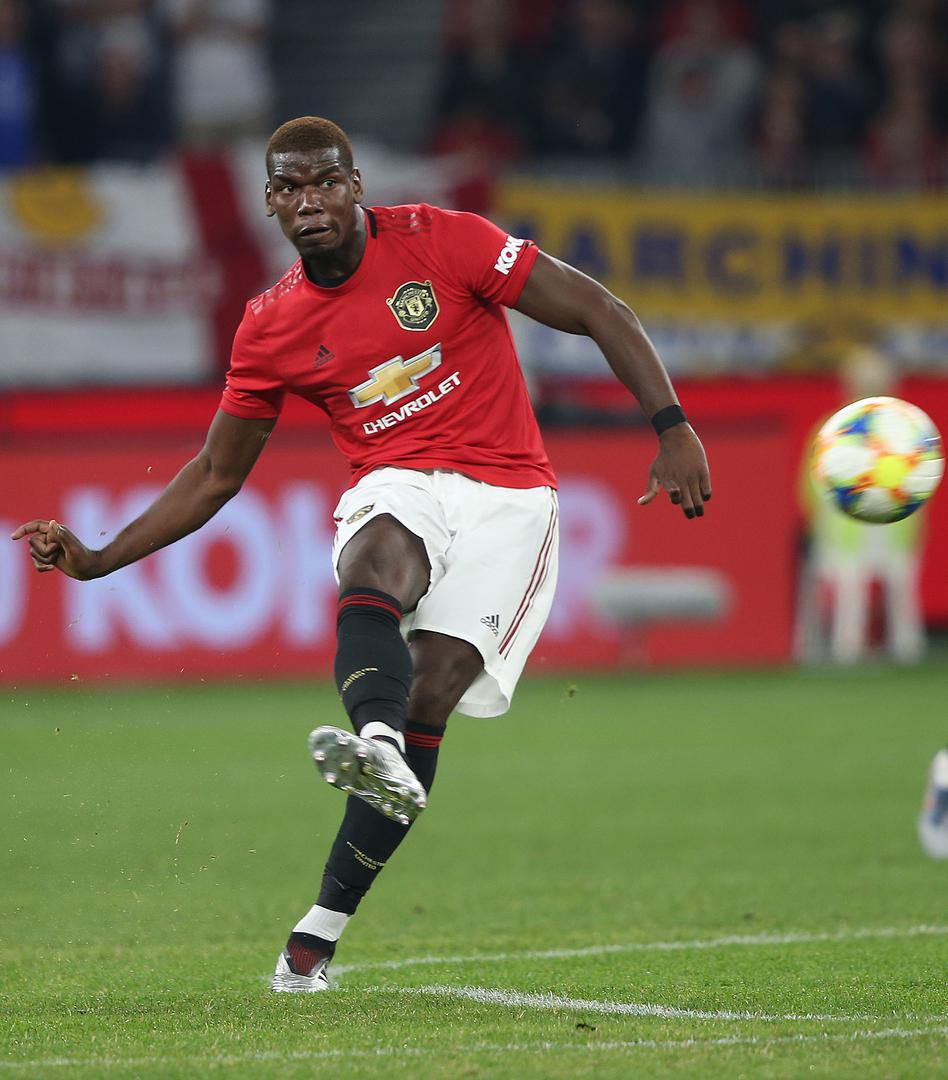 Paul Pogba takes a free-kick against Leeds in Perth