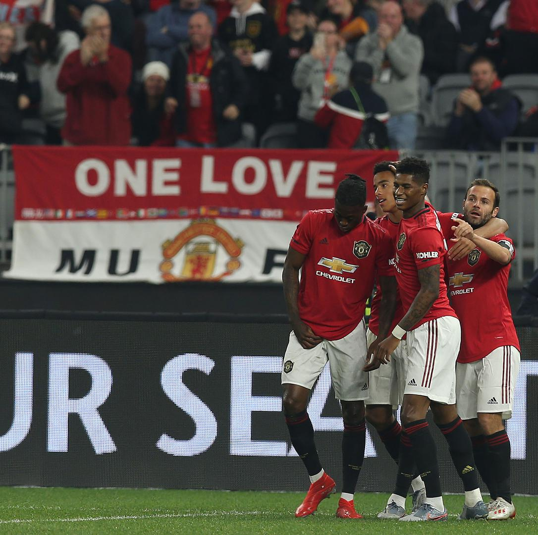 United players celebrate goal against Leeds United in Perth.