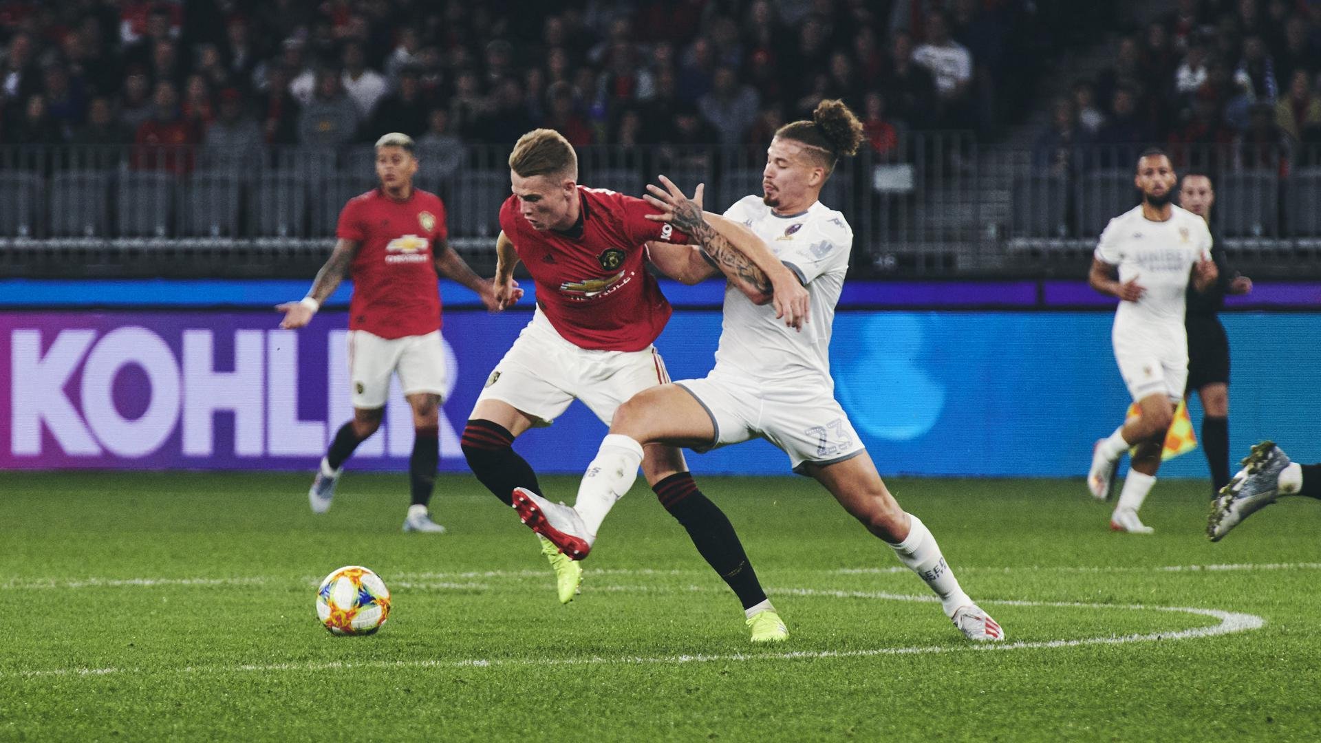 Scott McTominay powers through the midfield against Leeds.
