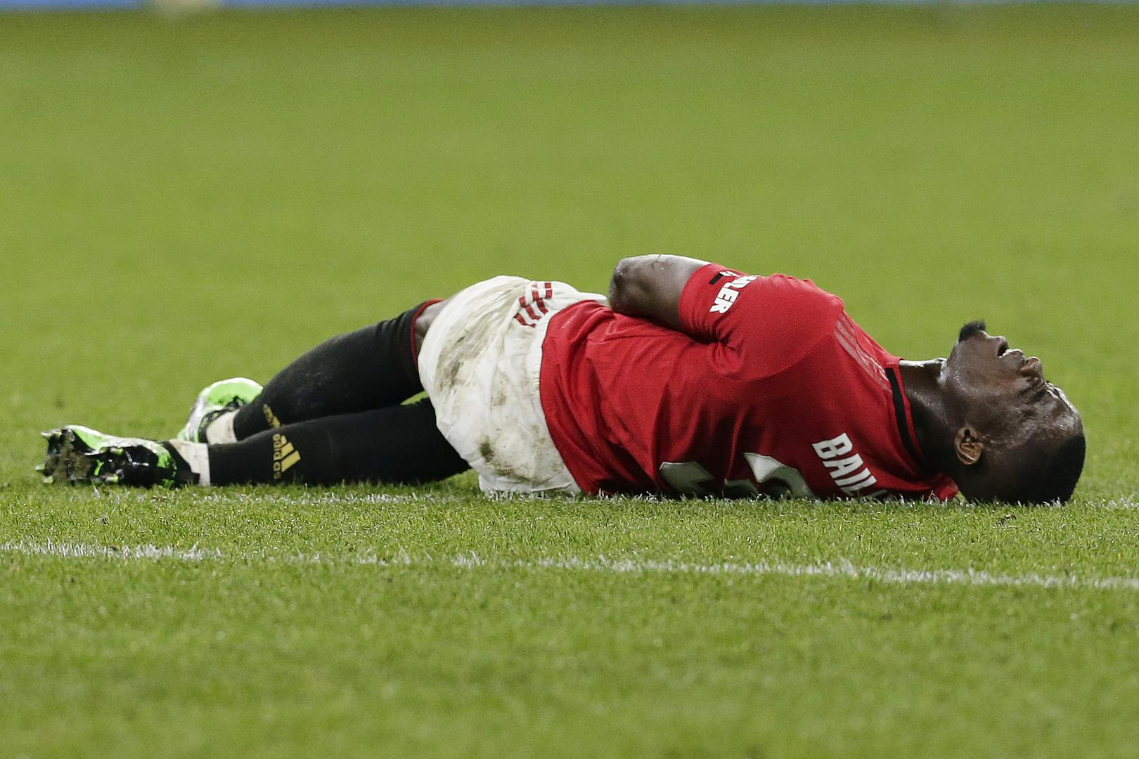 Eric Bailly lying down injured.