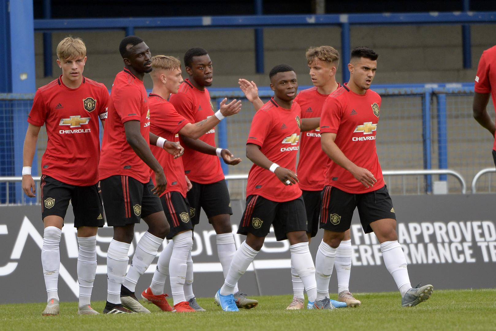 United youngsters celebrate scoring a goal against Rangers in the SuperCupNI.