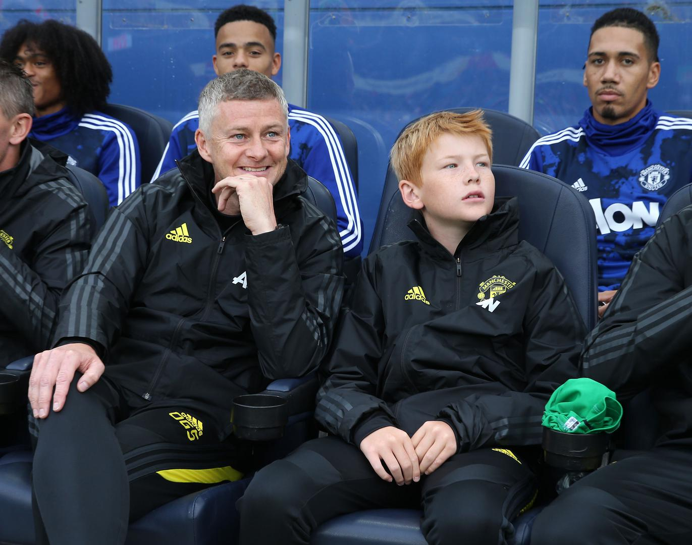 Ole Gunnar Solskjaer on the bench with his son Elijah.