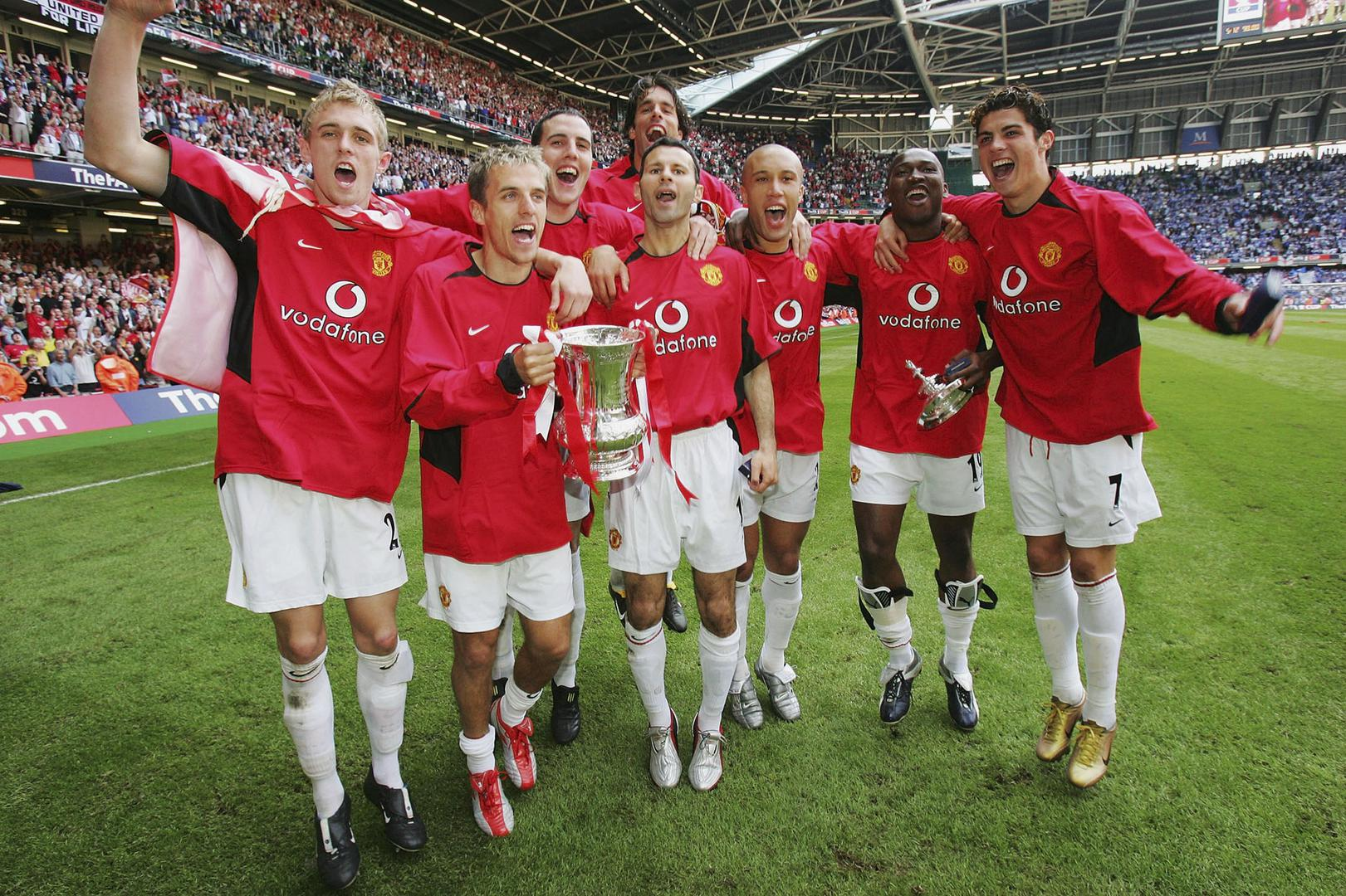 Manchester United players celebrate winning the 2004 FA Cup final.