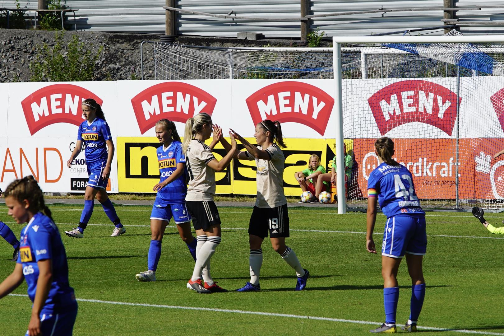 United Women celebrate a goal in Norway.