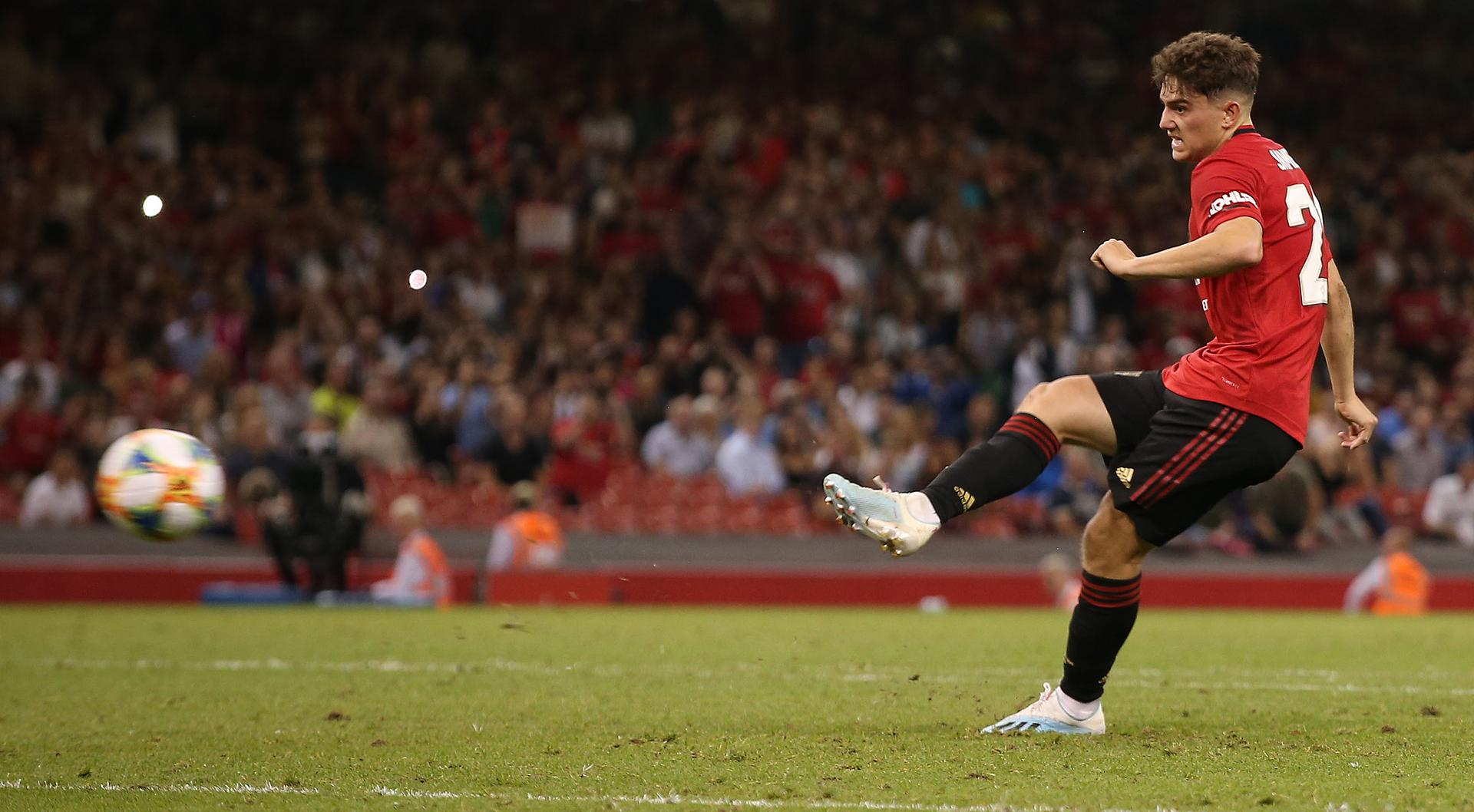Daniel James scores the winning penalty against AC Milan