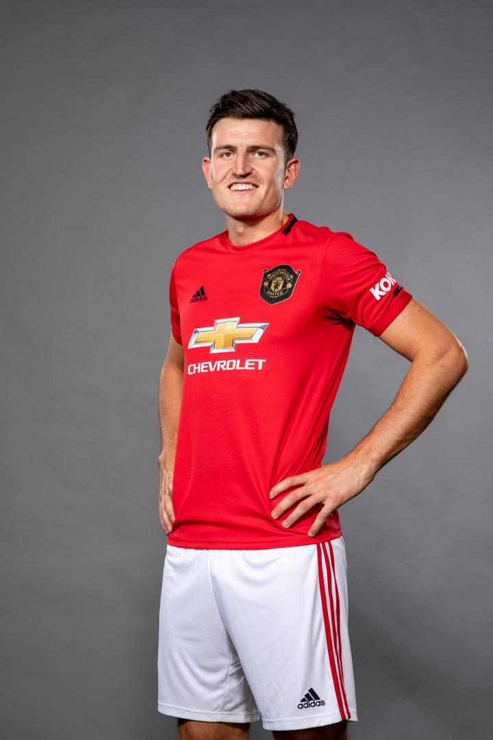 Harry Maguire wearing the Manchester United 2019/20 home kit.