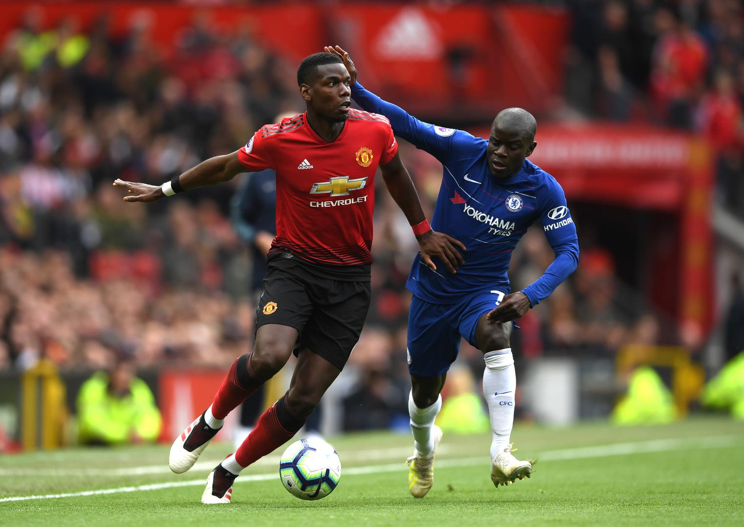 N'Golo Kante closes down Paul Pogba during Manchester United's Premier League game against Chelsea at Old Trafford in 2019/20.