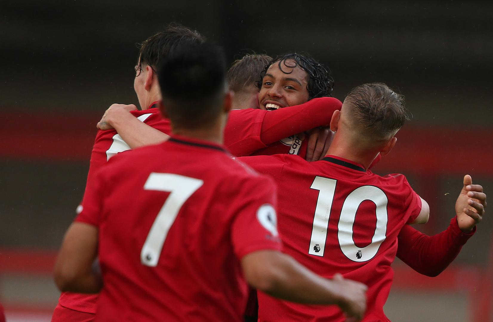 United celebrate D'Mani Mellor's goal in the first half.