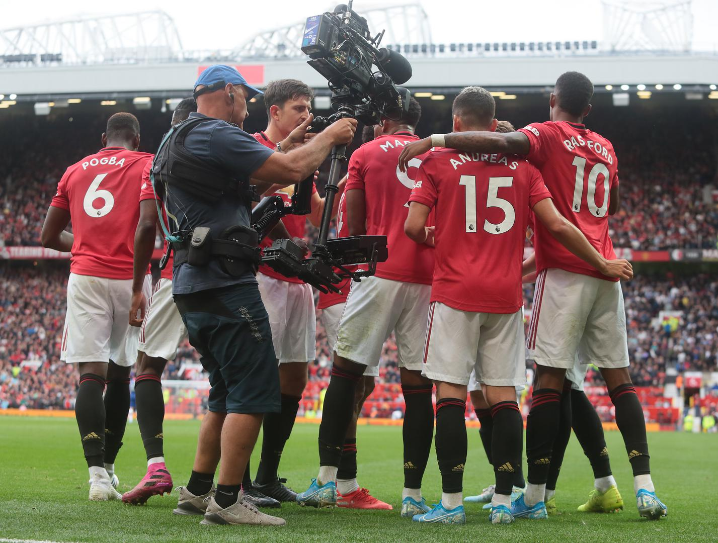 United players celebrating at Old Trafford.