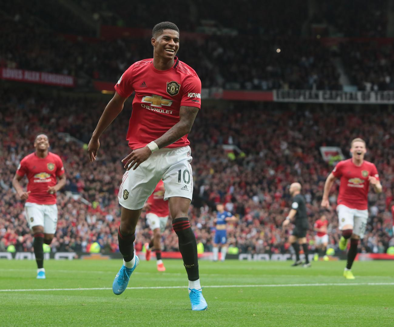 Marcus Rashford celebrates scoring against Chelsea