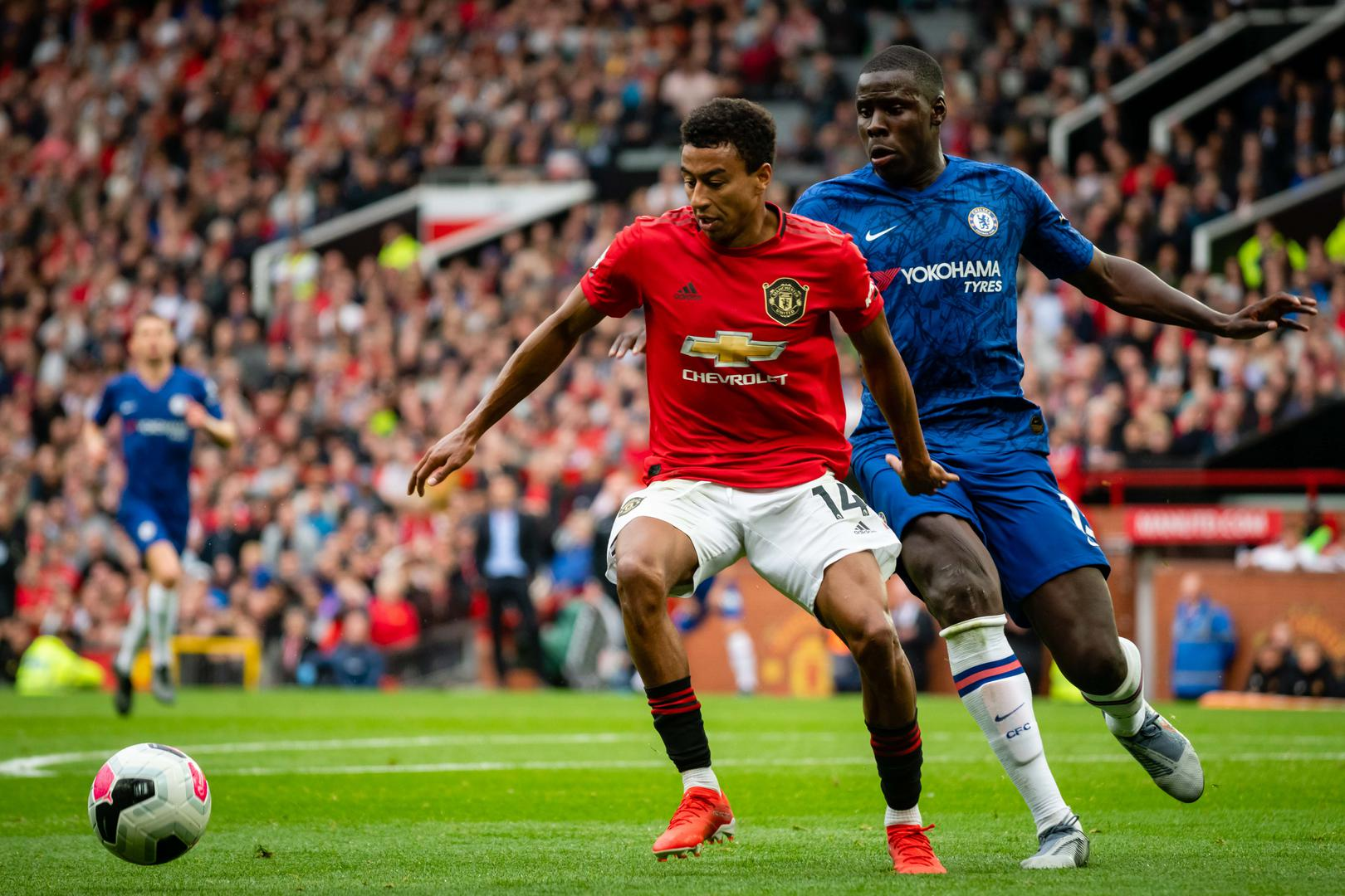 Jesse Lingard challenges Chelsea's Kurt Zouma to the ball.