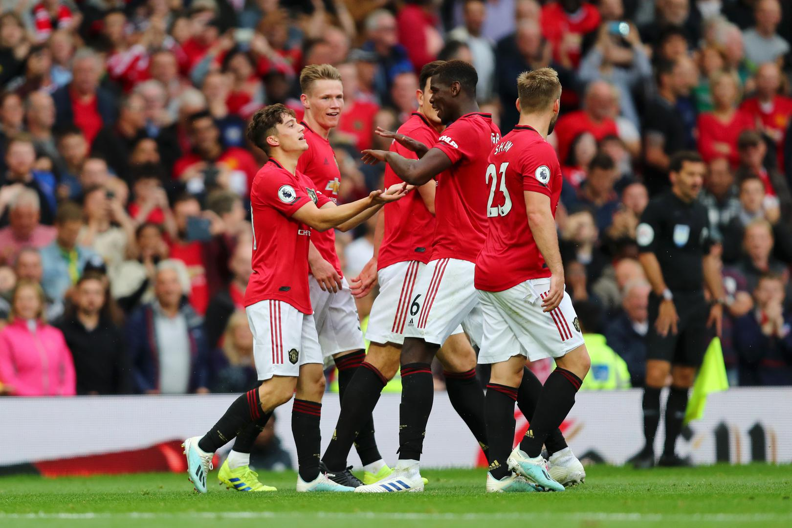 Manchester United players celebrate a goal against Chelsea