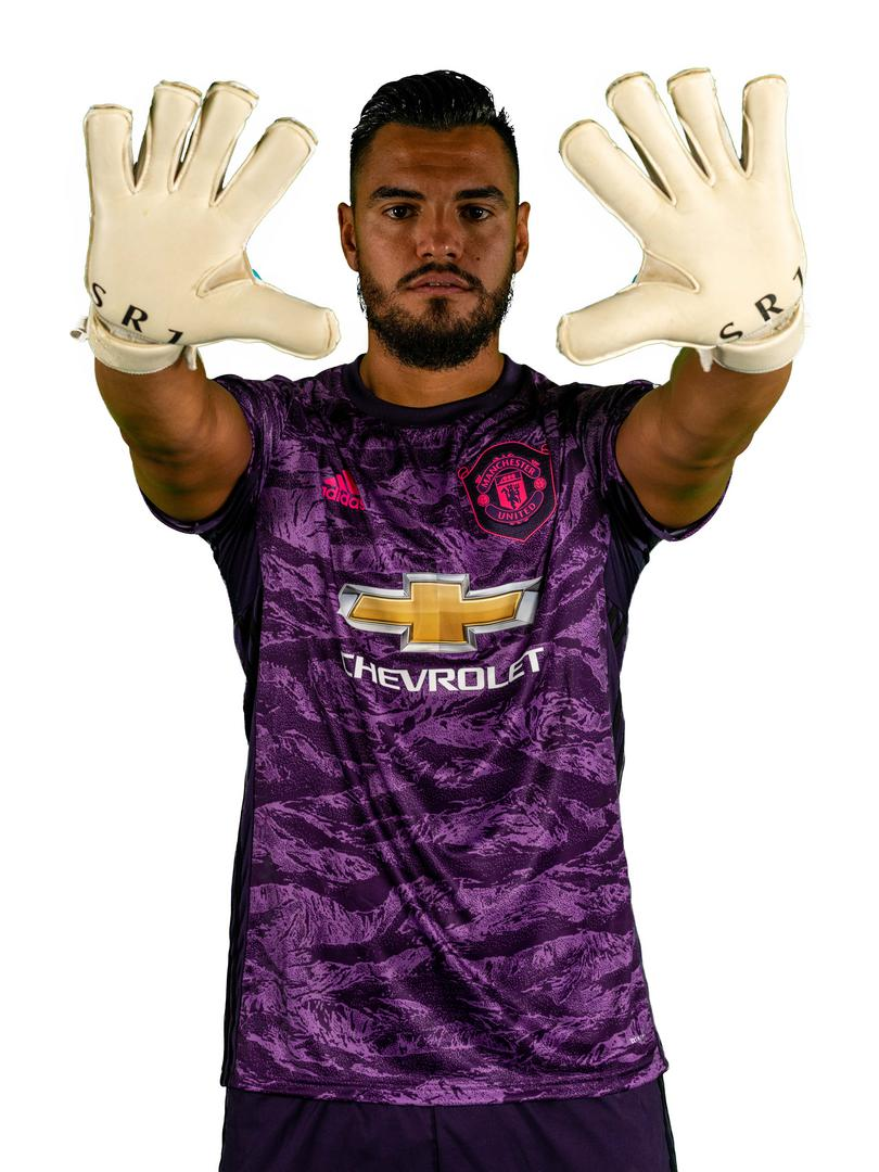 Sergio Romero shows off his custom-made gloves.