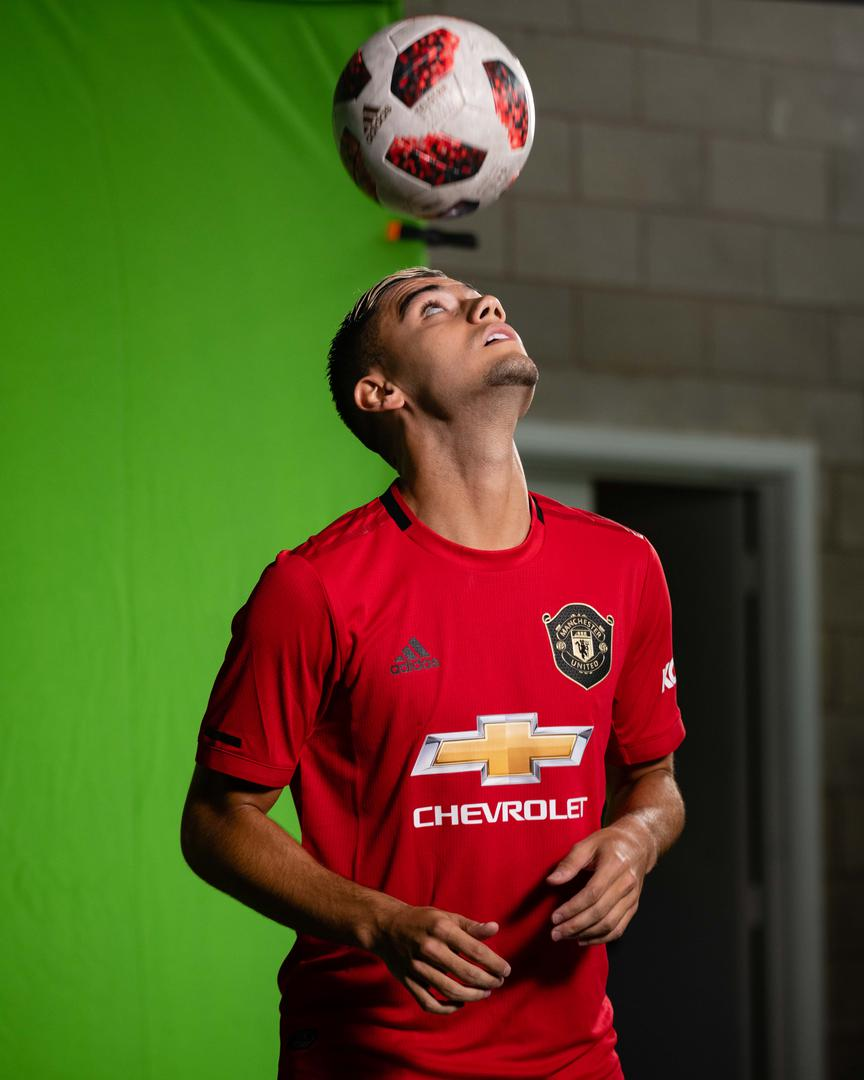 Andreas Pereira balances the ball on his head.