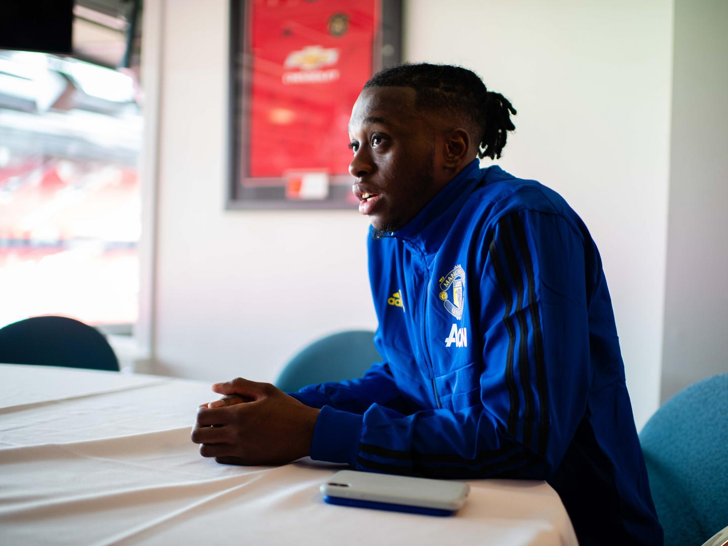 Aaron Wan-Bissaka talks to Man Utd's Steve Bartram at Old Trafford.