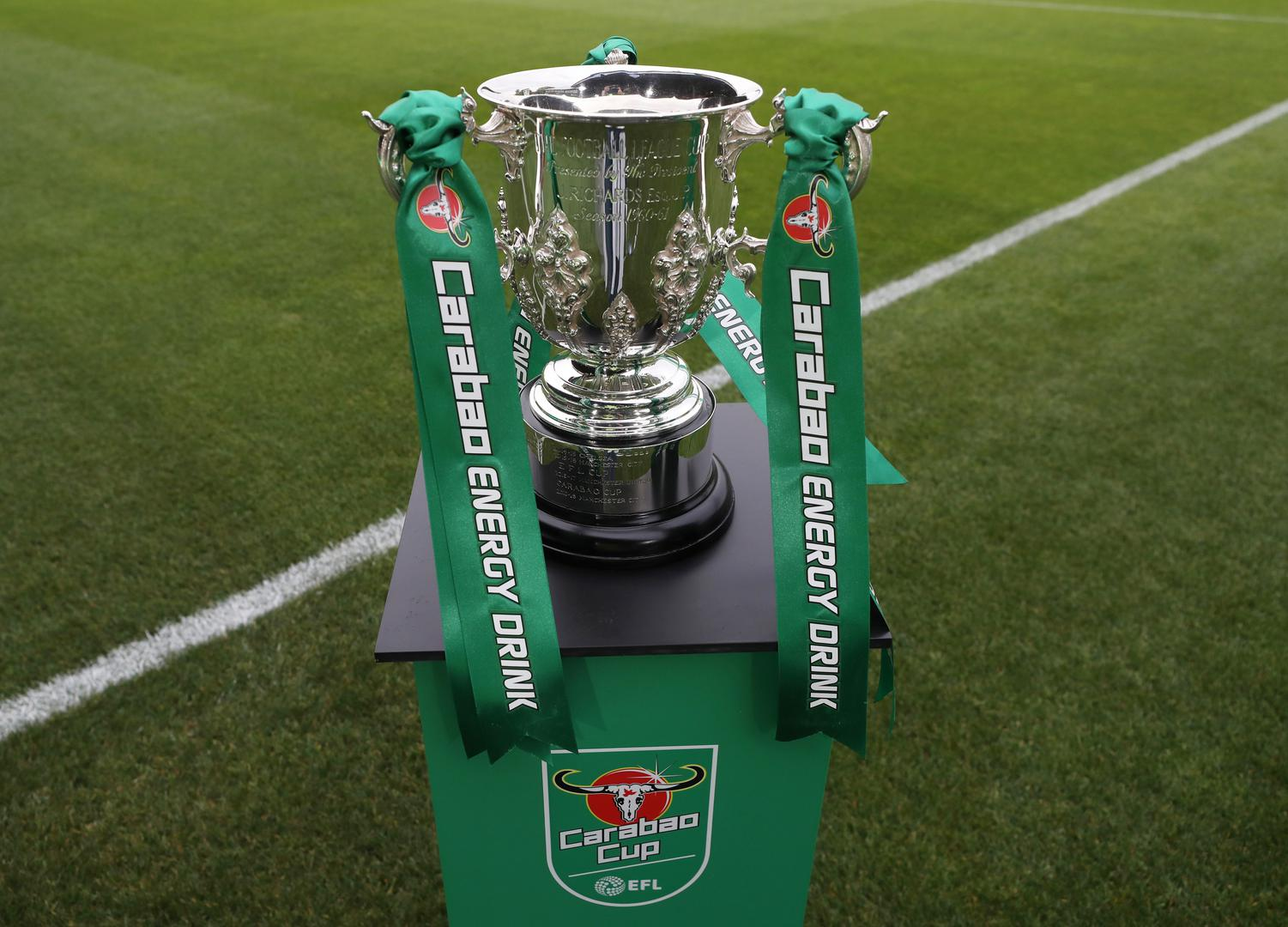 The Carabao Cup trophy on a platform.