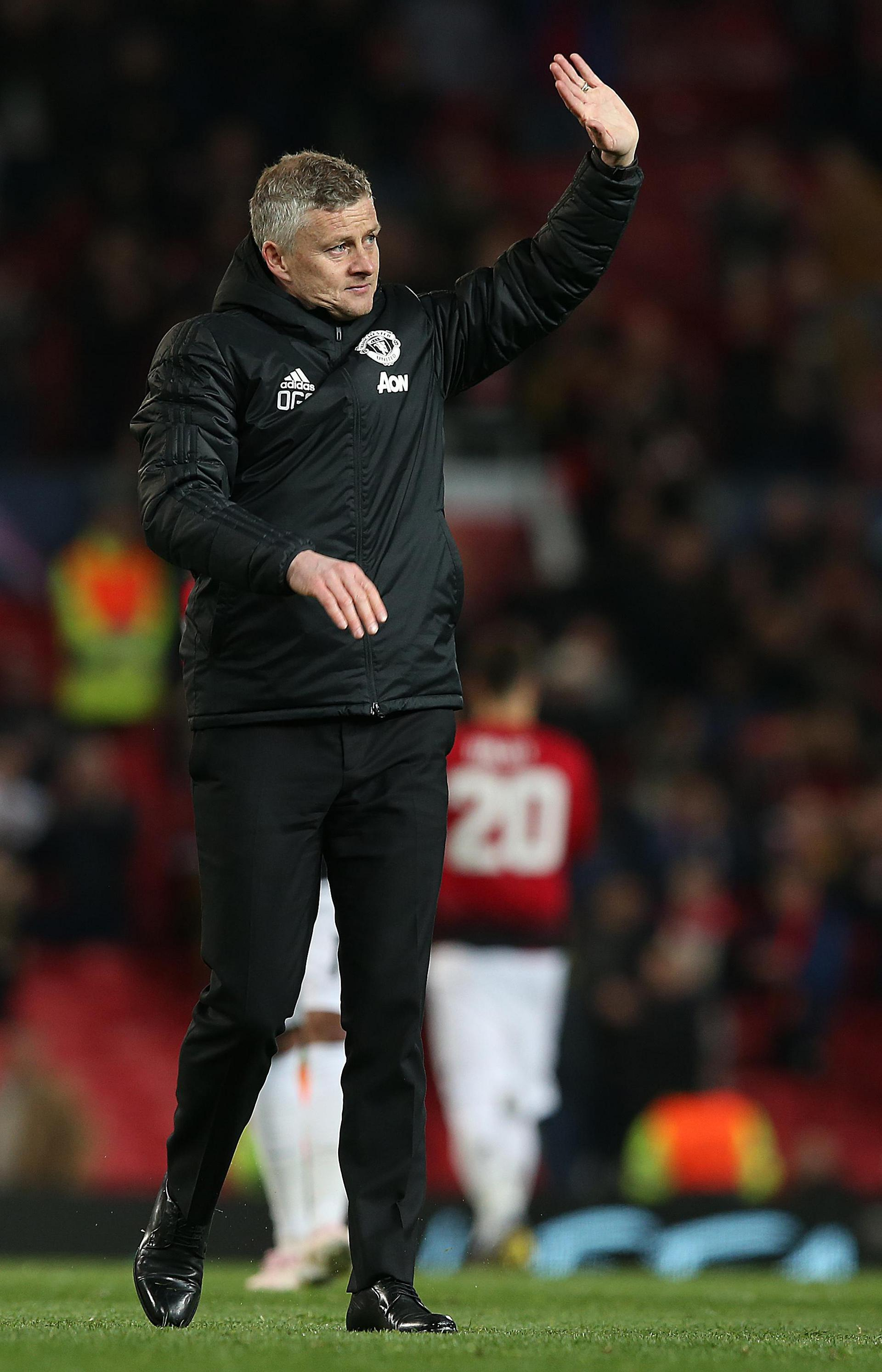 Ole Gunnar Solskjaer waves to the United fans at Old Trafford