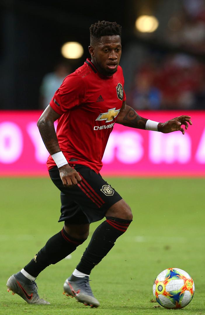 Fred playing for Manchester United against Inter Milan.