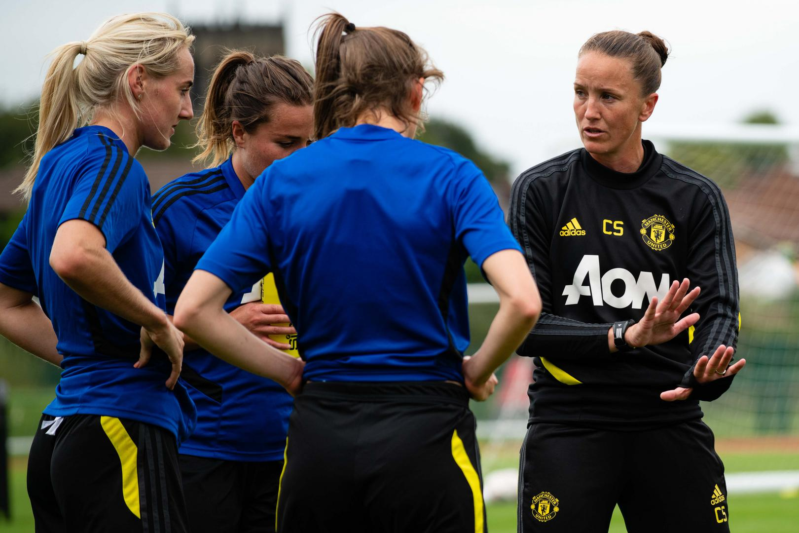 Casey Stoney with Man Utd Women in a training session