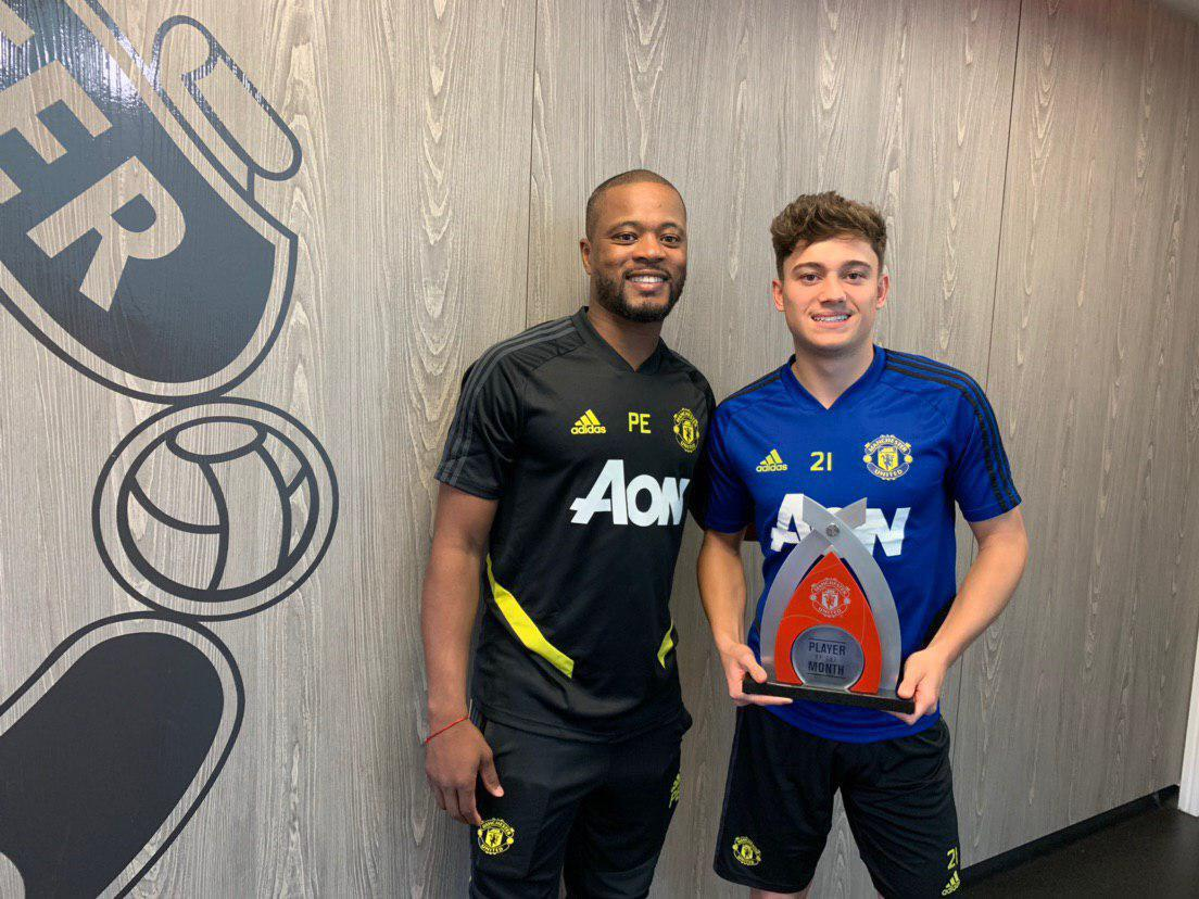 Patrice Evra with Daniel James at the Aon Training Complex.,