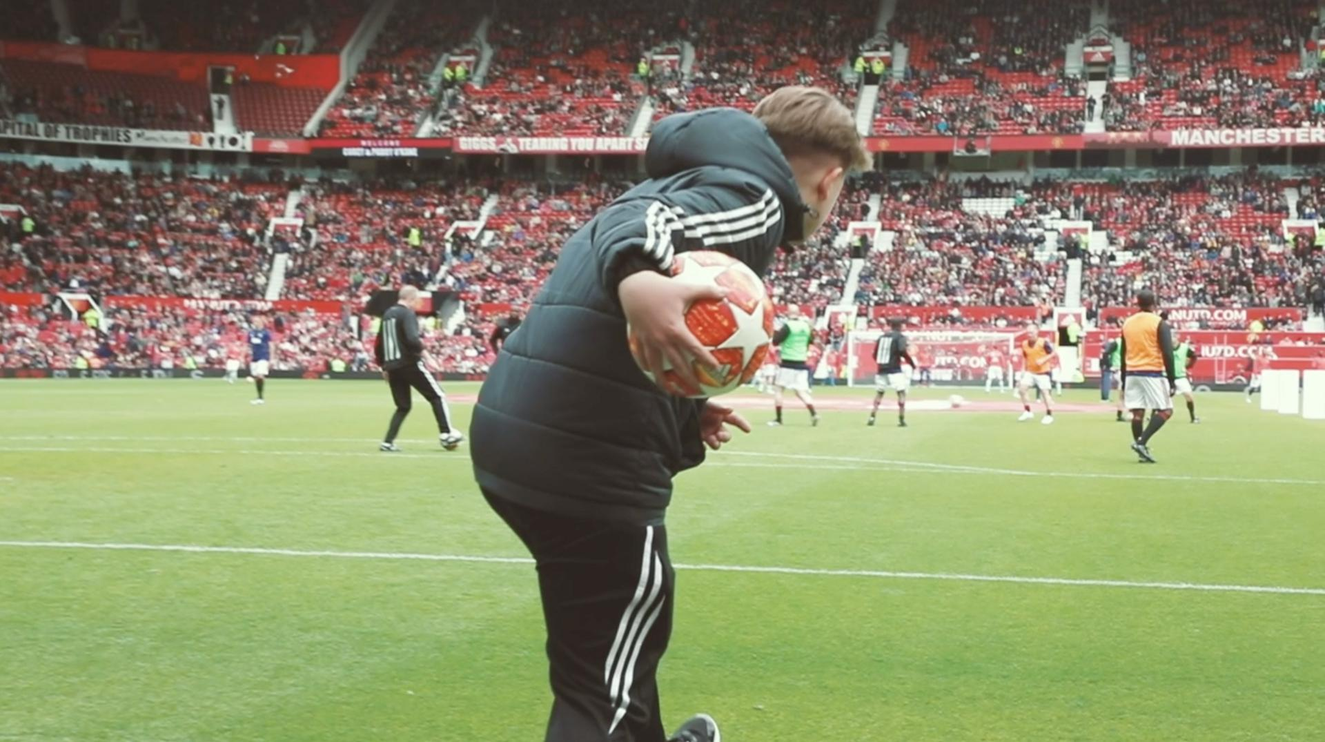 A youngster throws a ball while on work experience with the Manchester United Foundation.
