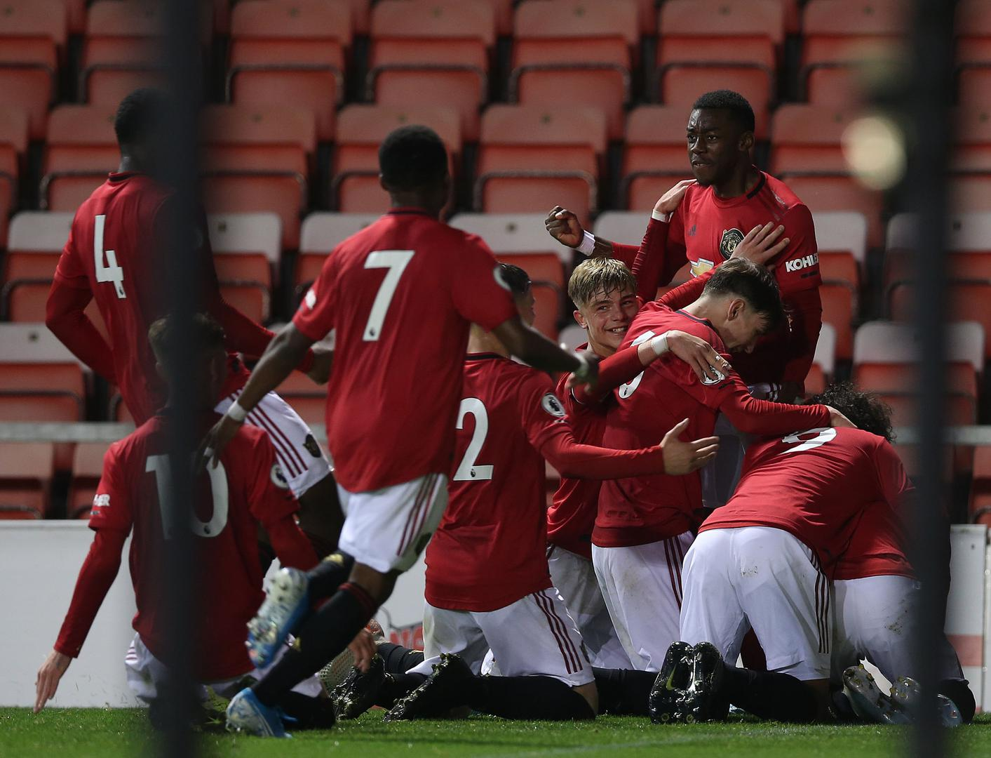 United celebrate the winning goal towards the end.