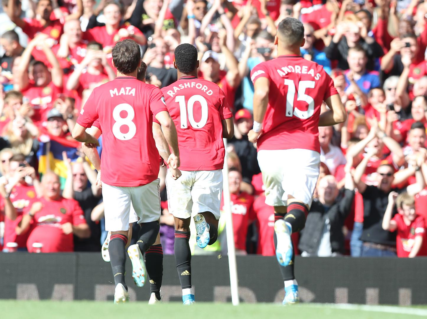 Juan Mata, Marcus Rashford and Andreas Pereira celebrate Manchester United's goal against Leicester City.