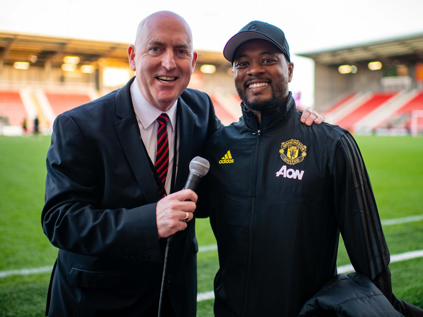 Patrice Evra with stadium 。。announcer Alan Keegan